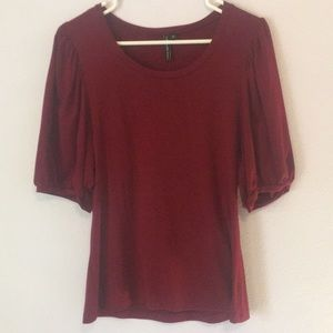 Round neck blouse with volume sleeve